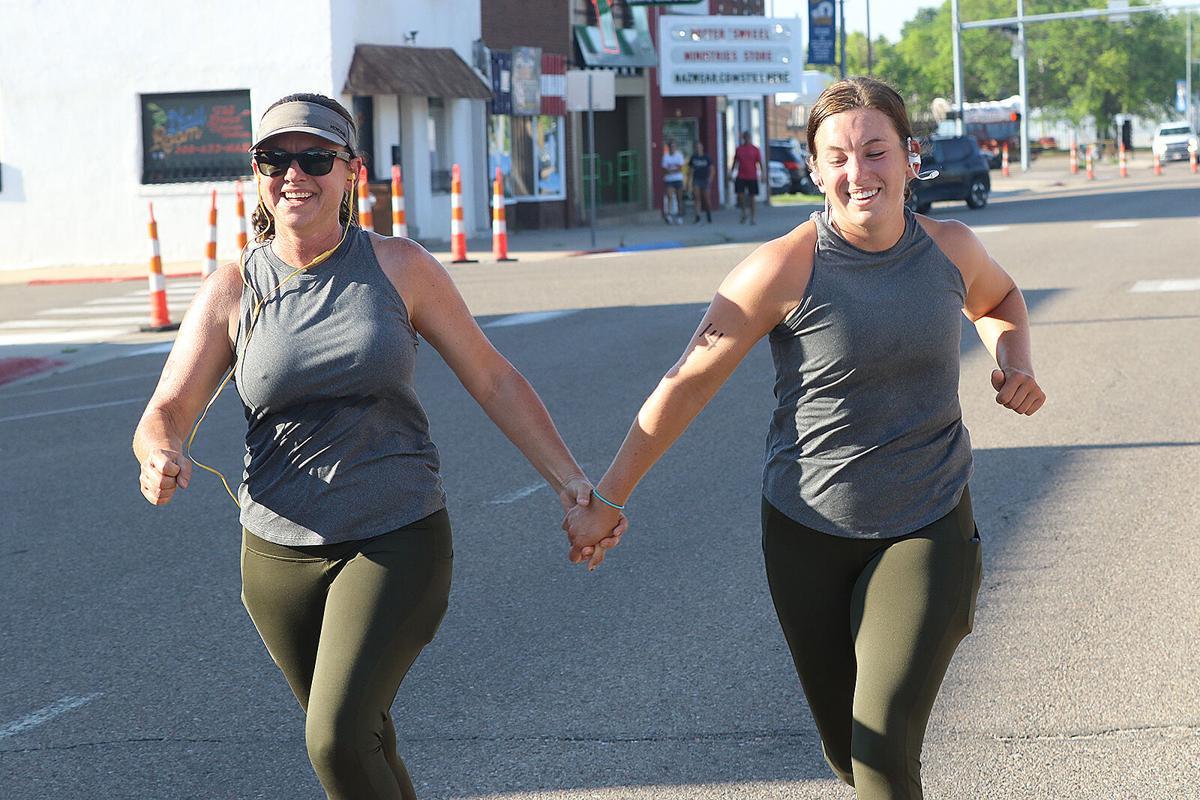 Kizzire, Freeburg claim wins in Don Childs Run