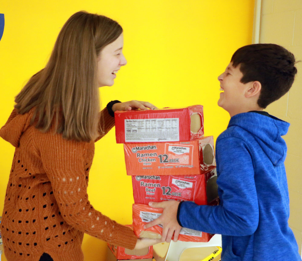 GJHS students collect canned goods for local holiday giving program