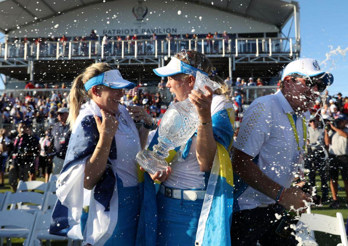Anna Nordqvist of Team Europe and Madelene Sagstrom of Team Europe celebrate with the Solheim Cup after winning over Team USA during day three of the Solheim Cup at the Inverness Club on September 6, 2021 in Toledo, Ohio.