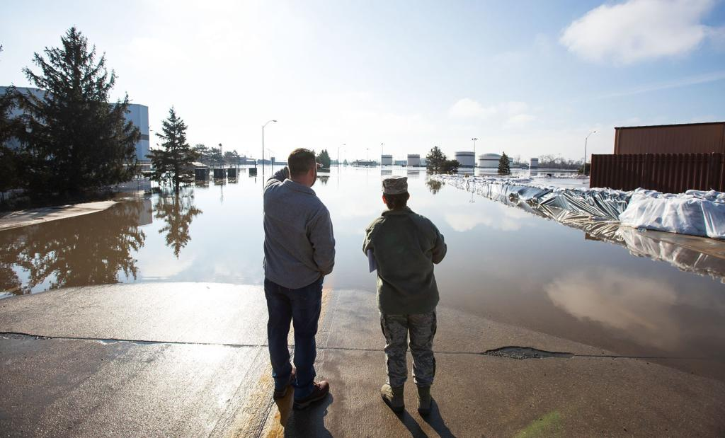 Floodwaters recede slightly at Offutt but rage at National