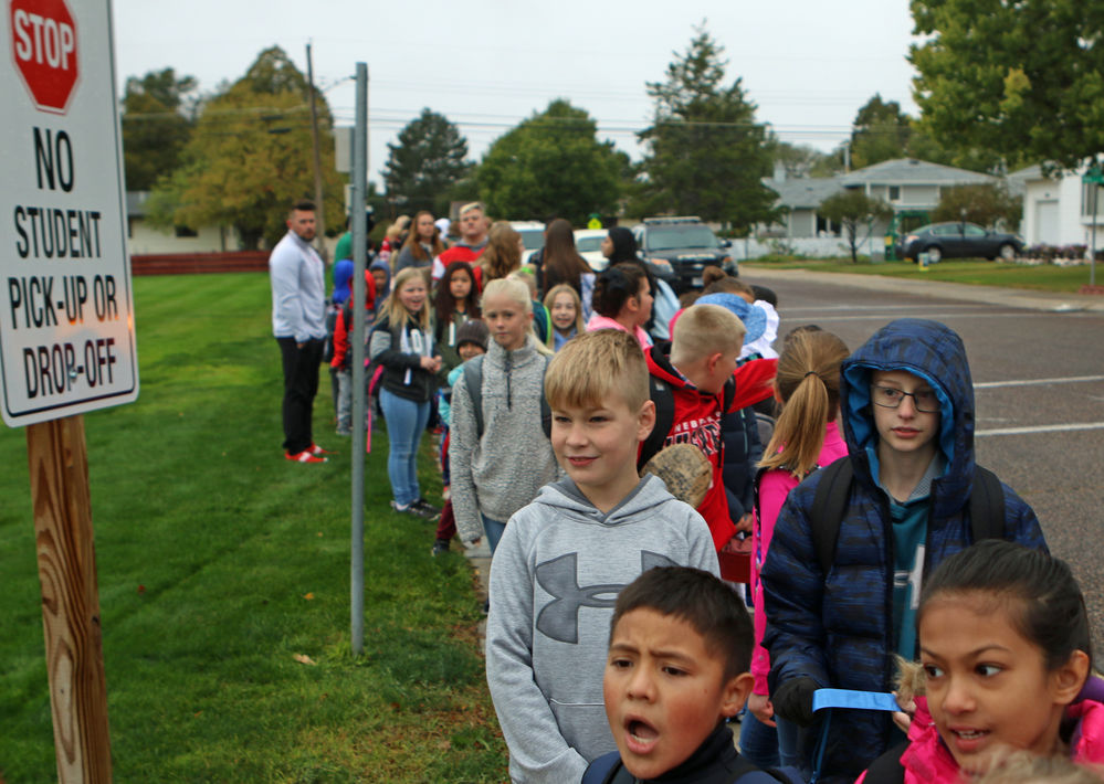 Local students join nationwide event, celebrate walking to school