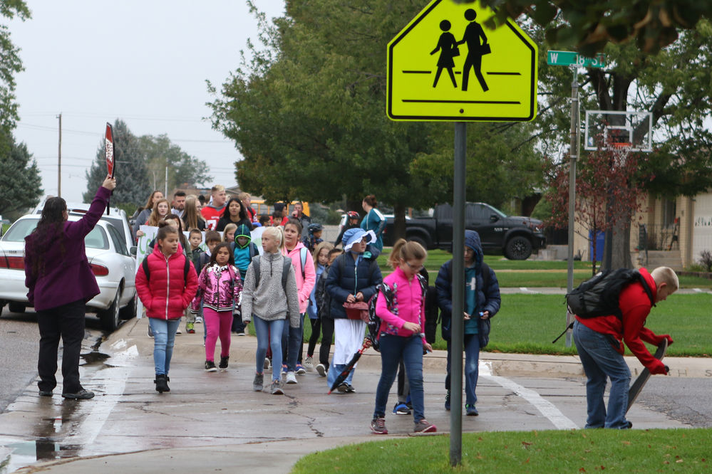 Walk to school day::2Local students join nationwide event, celebrate walking to school