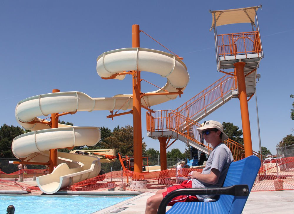 Replacing big blue new slide going up at gering swimming pool local news for Local swimming pools with slides