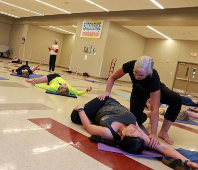 Sisters teach yoga for Tour de Nebraska cyclists