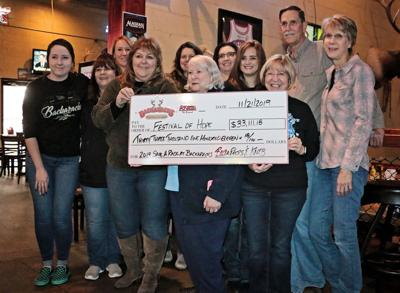 COMMUNITY Save A Rack raises $33,000 The annual event at Backaracks brought in funds for Festival of Hope.