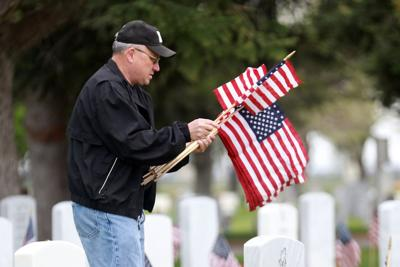 Volunteers decorate military graves