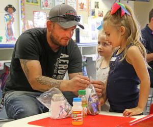 Kids share doughnuts and time with dads at Kinderkamp