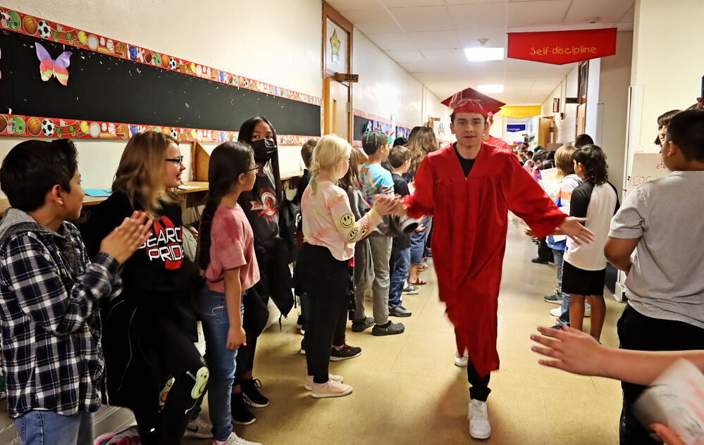 Graduating seniors celebrate at their former elementary schools