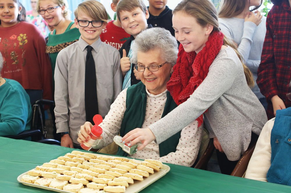 Westmoor students sing carols, decorate cookies with Northfield Retirement residents