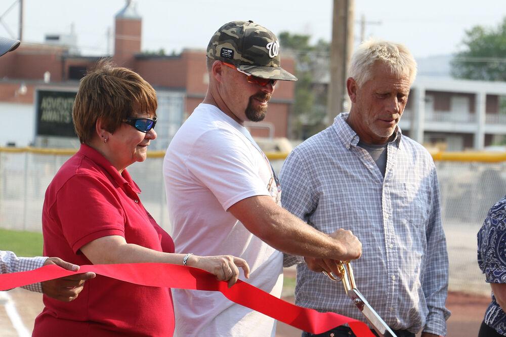 Ribbon cuttings mark opening of pedestrian bridge, 23 Club fields