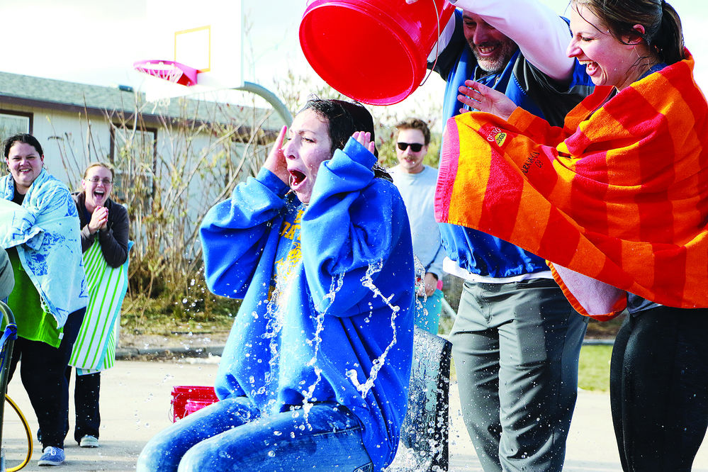 Gering teachers get doused after challenge