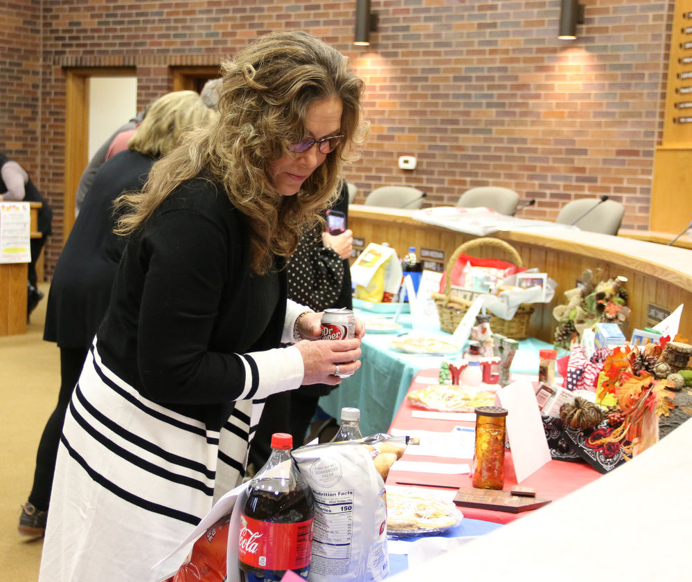 Gering employees help raise money for United Way with purchase of baked goods, craft and other items.