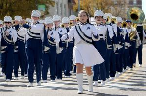 High school bands march down Broadway as part of annual competition