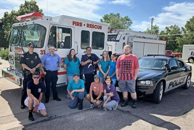 Firefighters, police donate funds to humane society