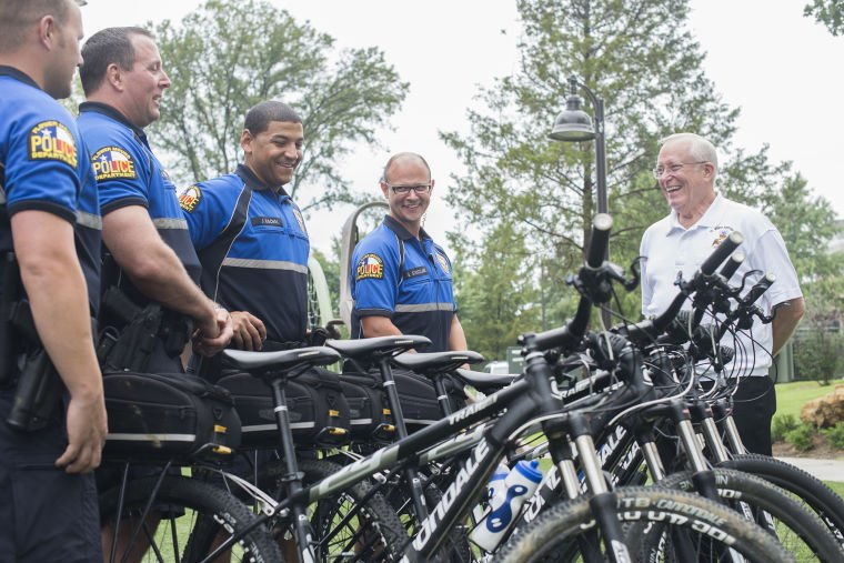 Flower Mound police officers Johnson, White, Rachal and Strickland are shown with the department's new bicycles, along with David Sebastian of Scottish Rite ...