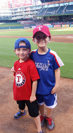 Charlie White and Micah Ahern at the 2015 Childhood Cancer Awareness Night hosted by the Texas Rangers.