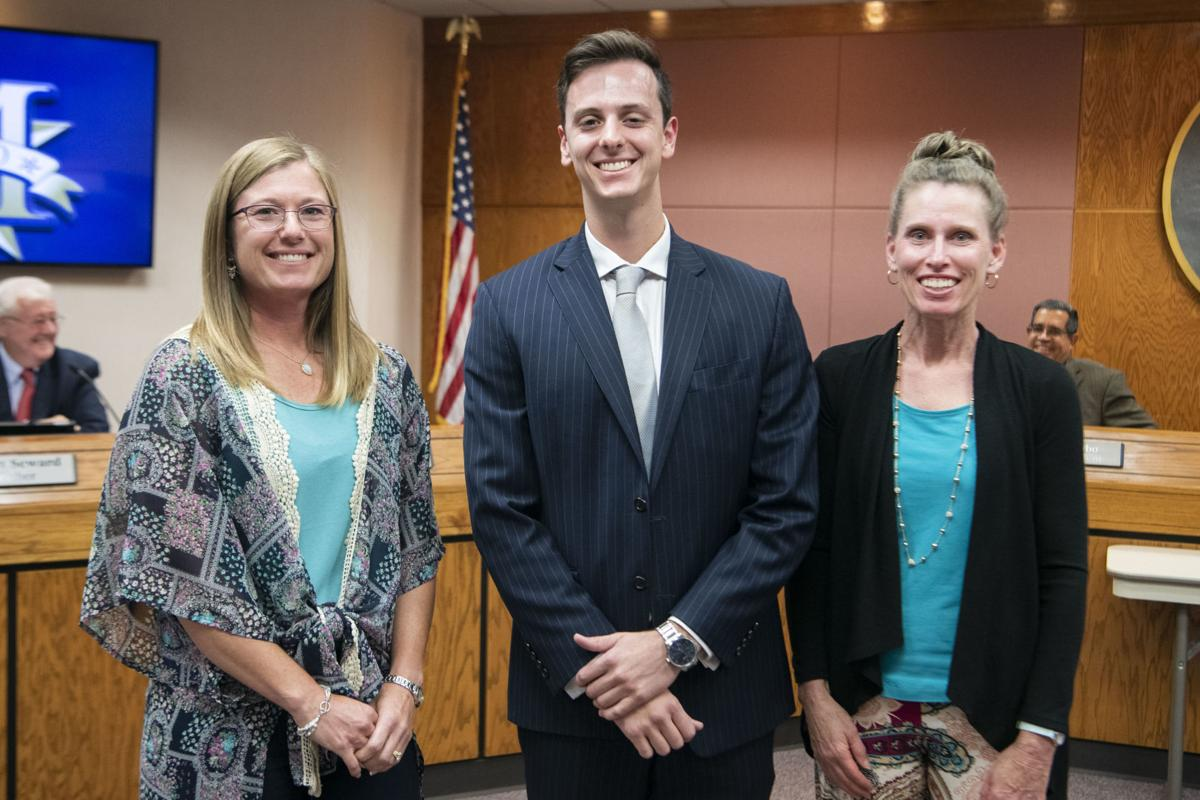 Gray, Price educators inducted into Apple Corps