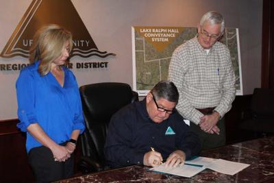 Lake Ralph Hall permit signing