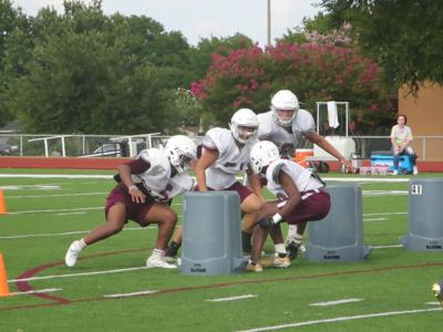 Plano players preach unity during opening week of practice