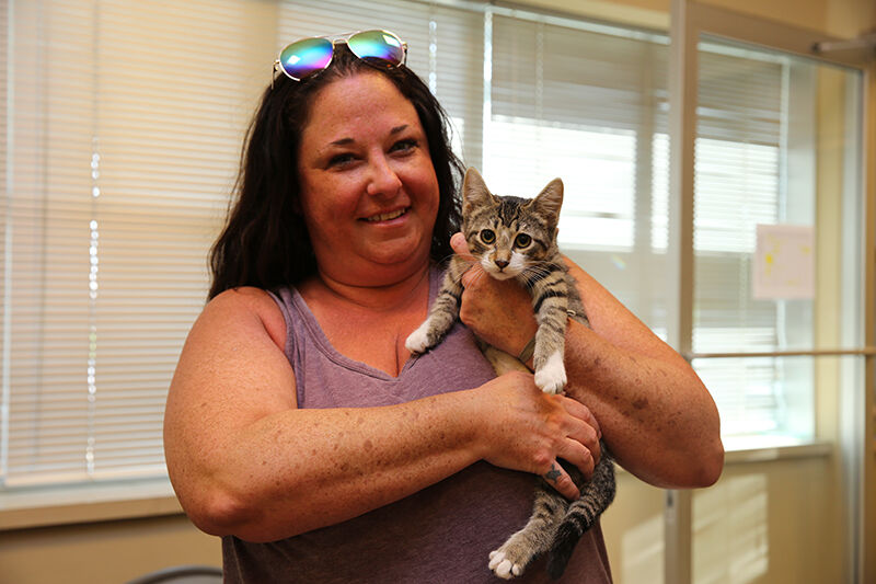 Clear the Shelters - Mesquite TX - woman adopts kitten.jpg