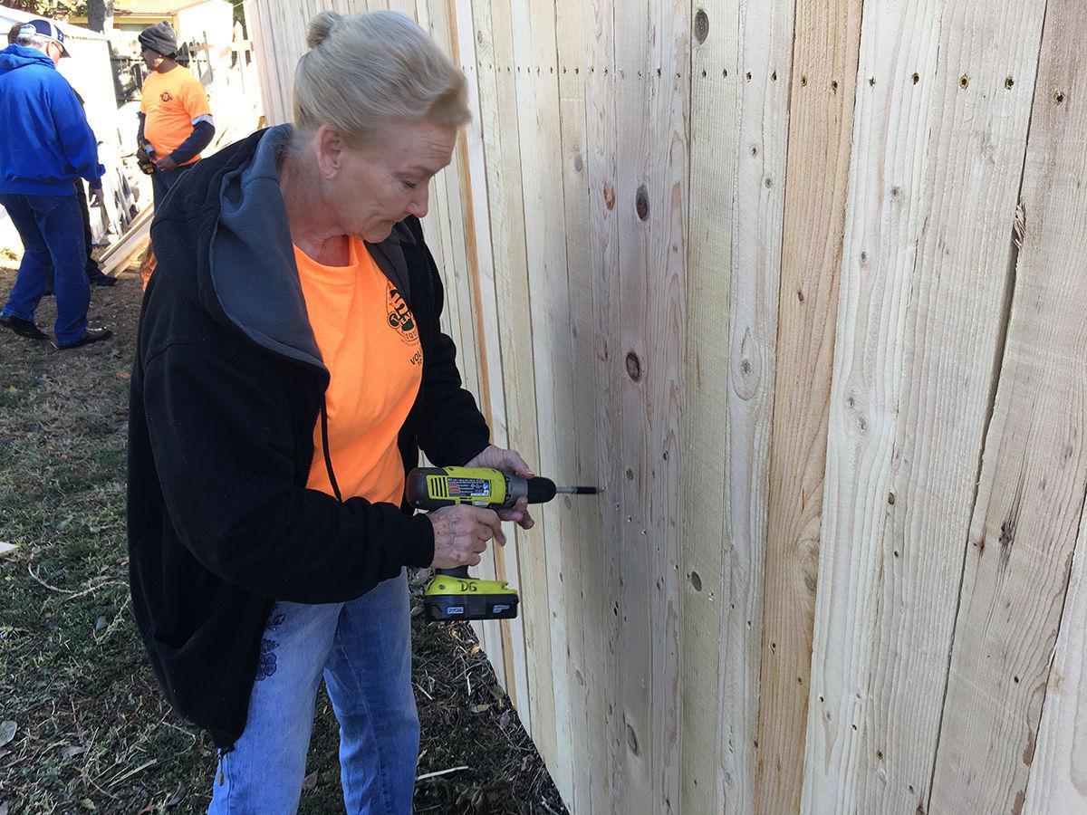 10-12-19 Addressing Mesquite Day - Volunteer assembles new fence.jpg