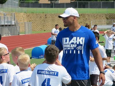 hot sale online 3f4fb 33929 Dak does Lake Dallas: Cowboys quarterback holds camp for 900 ...