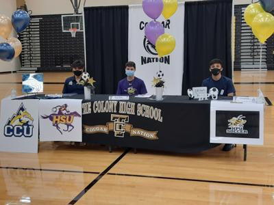 Cougar boys soccer college signing
