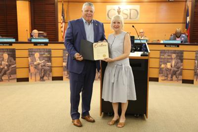 Garland ISD staff gets composition published