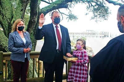 Charles Miller takes oath of office