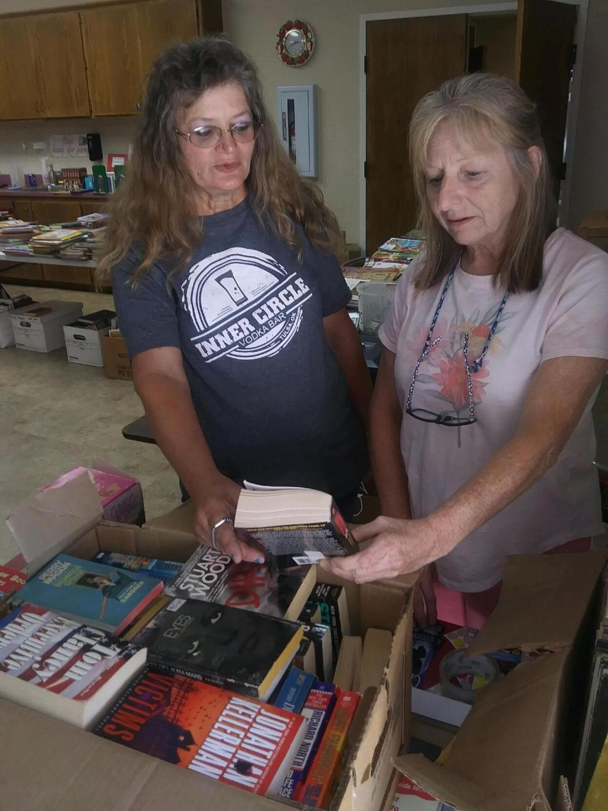 Local residents score big in Friends of the Library book sale