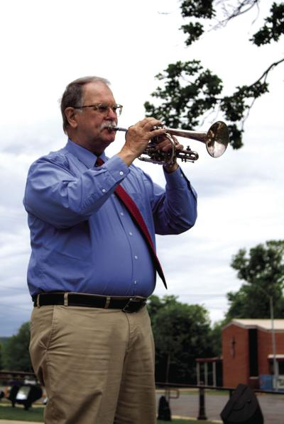 Local minister plays Taps for Remembrance on Monday