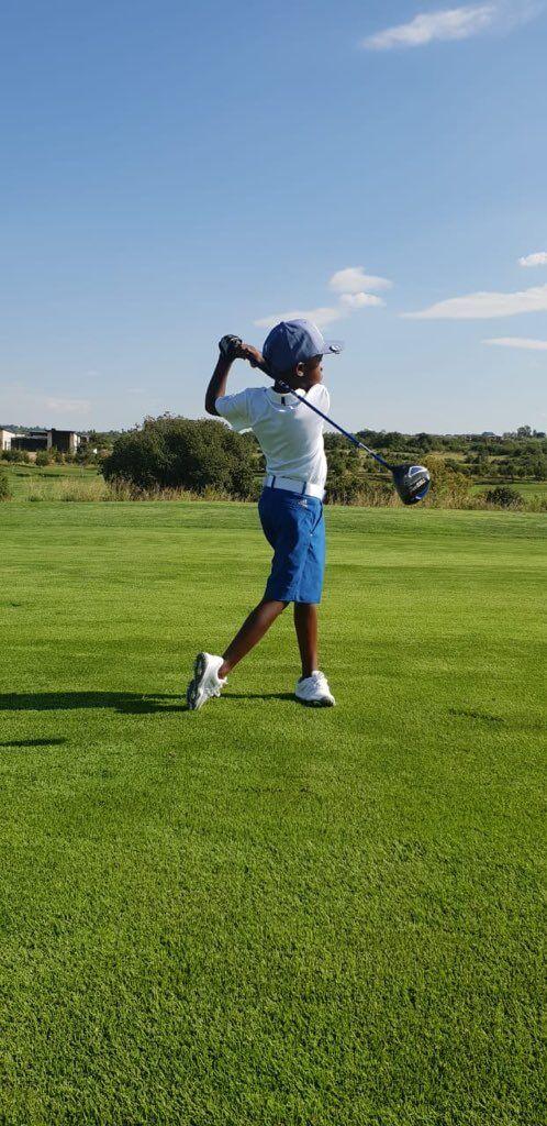 Black boy playing golf