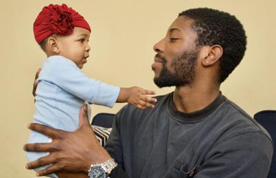 Black Father Trevon Robinson with daughter