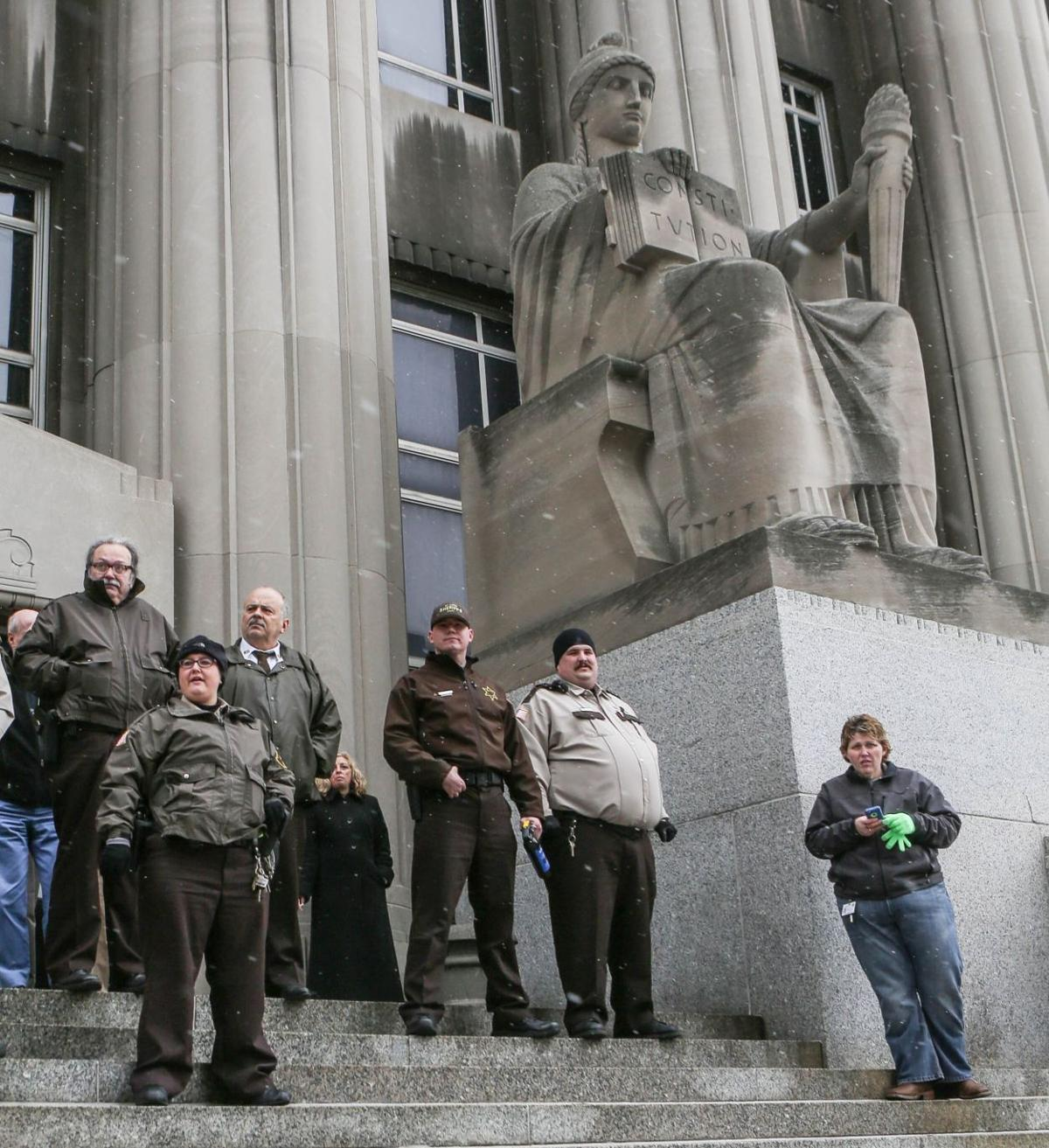 Carnahan Courthouse guarded by sheriffs