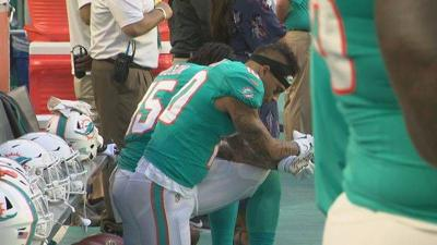 Three Miami Dolphins players kneel during anthem | Local