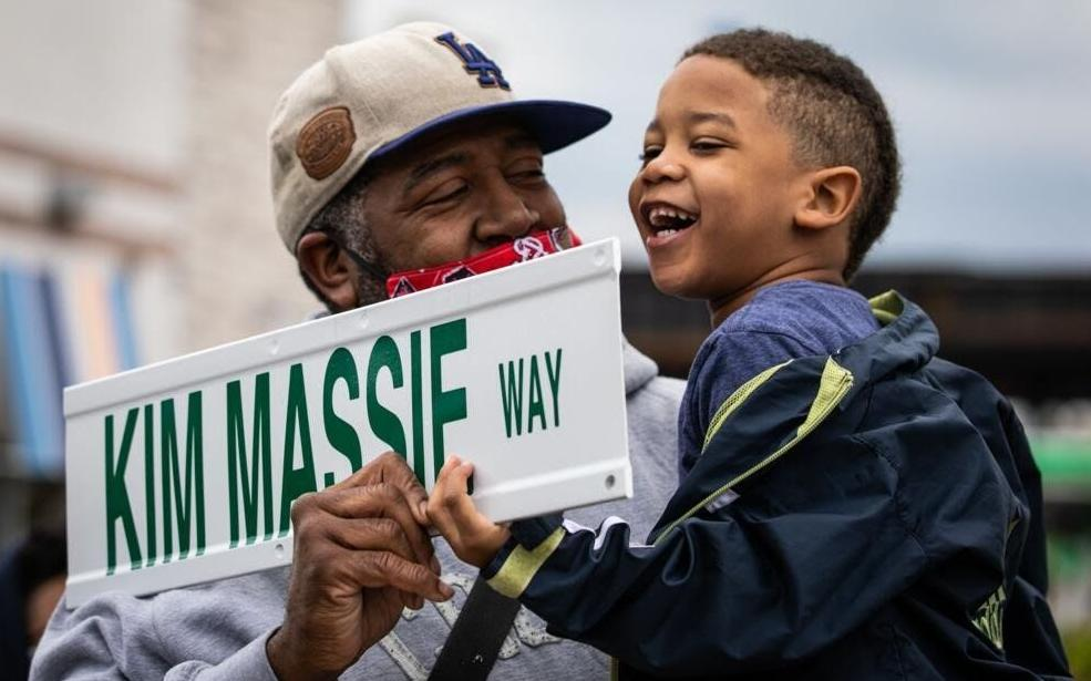 Adam Massie and Adam Massie, Jr., celebrate Kim Massie street naming