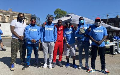 Black Men Build Street Sweep
