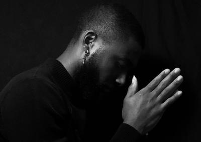 Black Man praying or concentrating