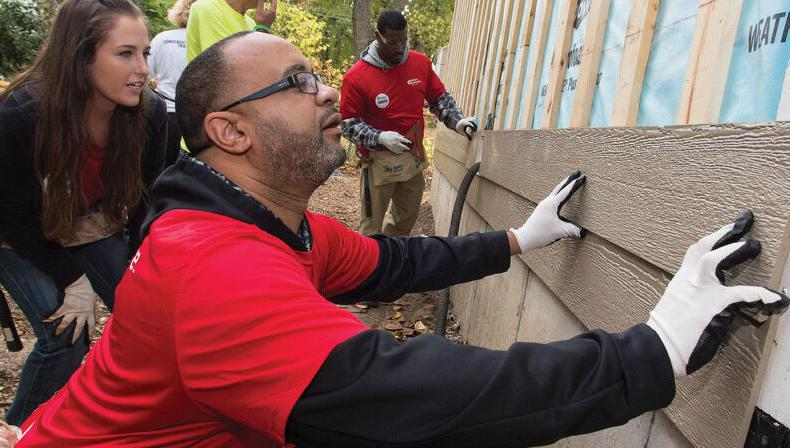 Alex Fennoy working with Habitat for Humanity