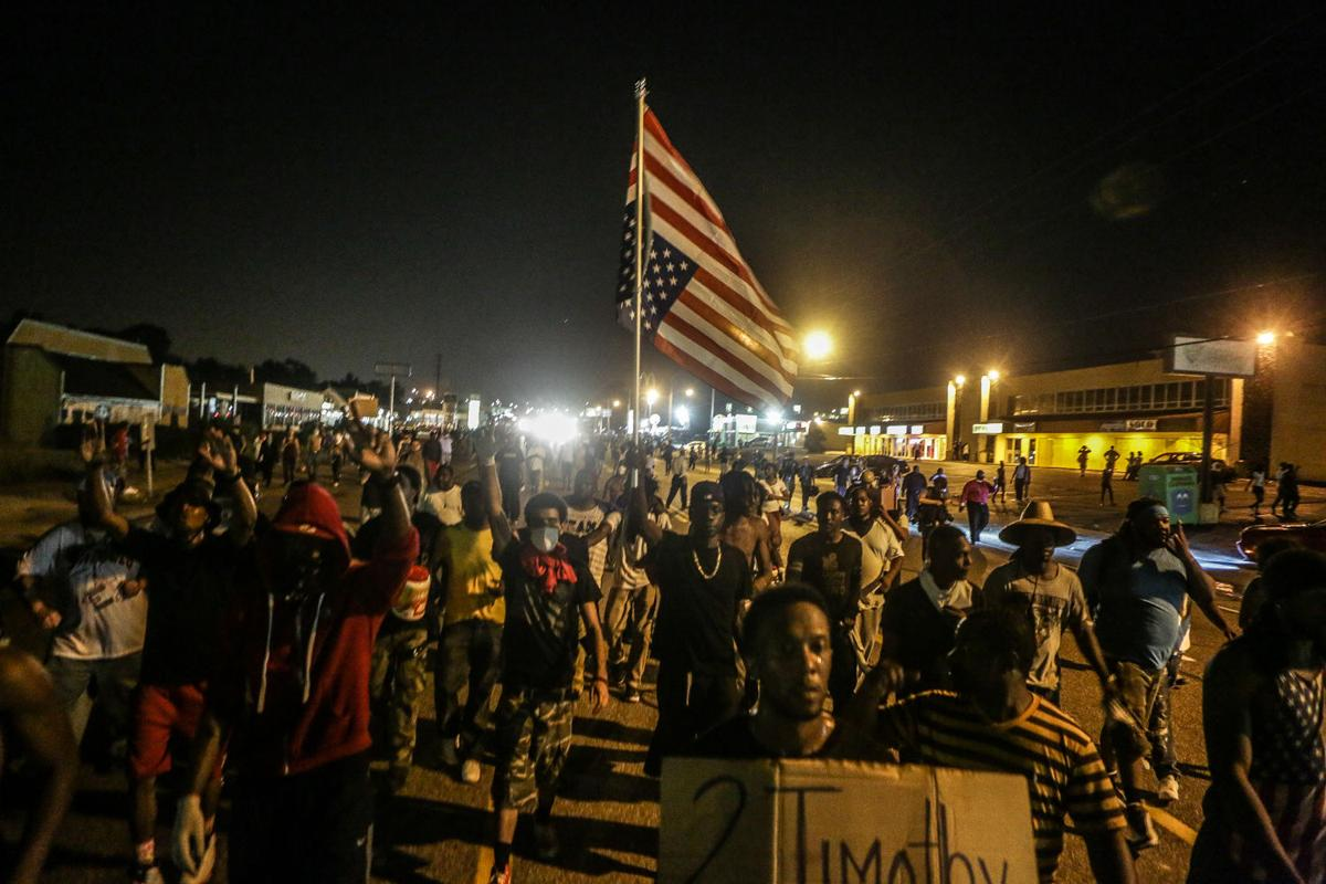 Peaceful protestors rally around the flag in the Ferguson protest zone