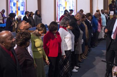 Black church praying