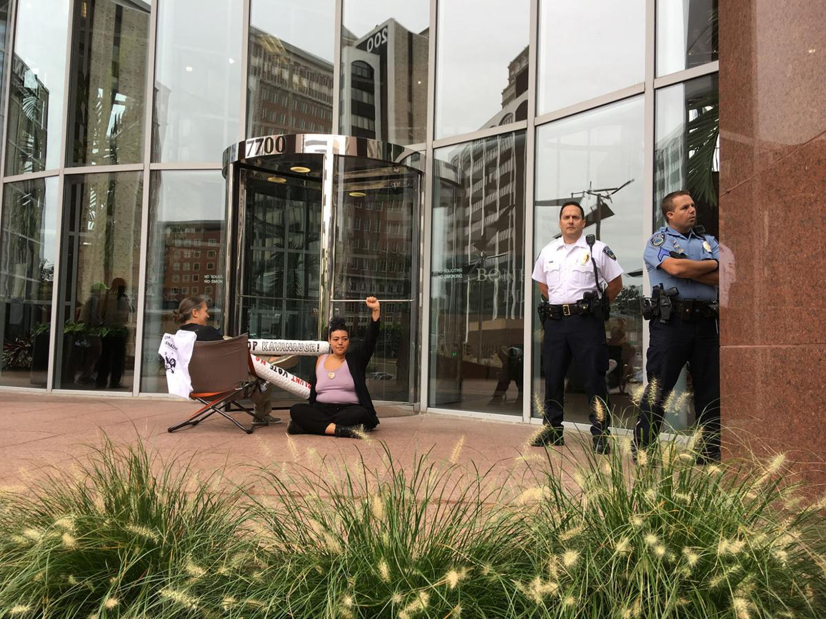 Three people chained themselves to the door of US Senator Roy Blunt's office in Clayton, Mo.