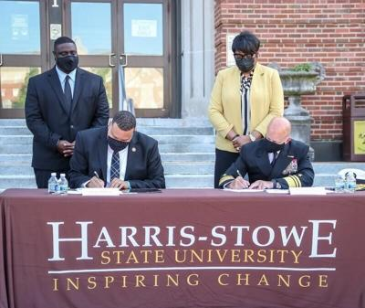 Harris-Stowe State University President Corey S. Bradford Sr. and Vice Adm. Robert D. Sharp, NGA director, signed an agreement