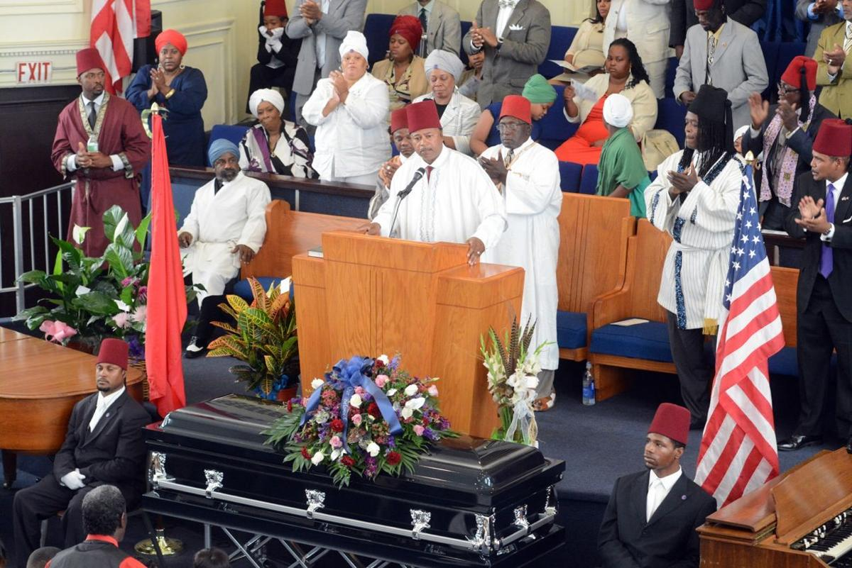 Brother T. Irons-El speaks during Mansur Ball-Bey funeral