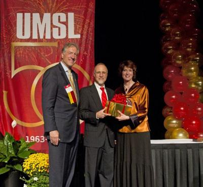 UMSL Vice Chancellor for Advancement Martin Leifeld, Chancellor Thomas George and Barbara Harbach, professor of music