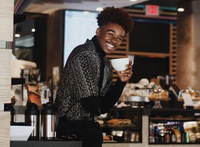 Young man drinking coffee in restaurants