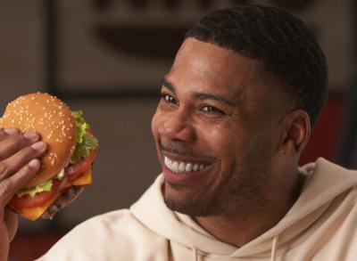 Rapper Nelly posing for Burger King advertisement.