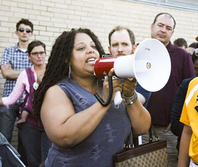 Protesters canvass North side to lend support through voter registration, community resources