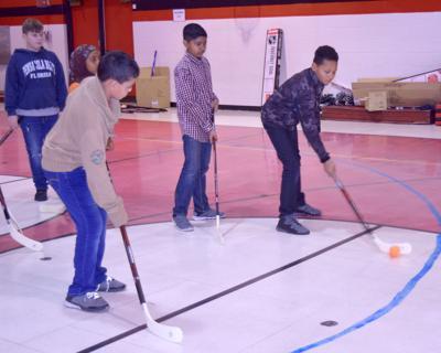 Blues teach hockey, donate equipment to McNair Elementary