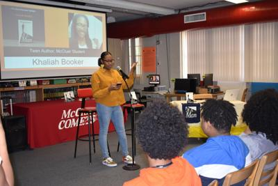 McCluer senior Khaliah Booker publishes a novel, introduces 'Of a Man' to fellow students at recent book signing
